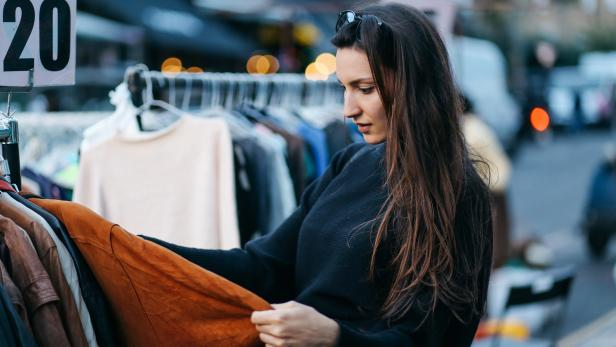 Young woman shopping in London second hand marketplace